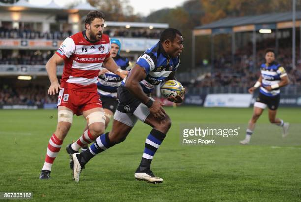 Semesa Rokoduguni of Bath breaks through to score a late try during the Aviva Premiership match between Bath Rugby and Gloucester Rugby at the...