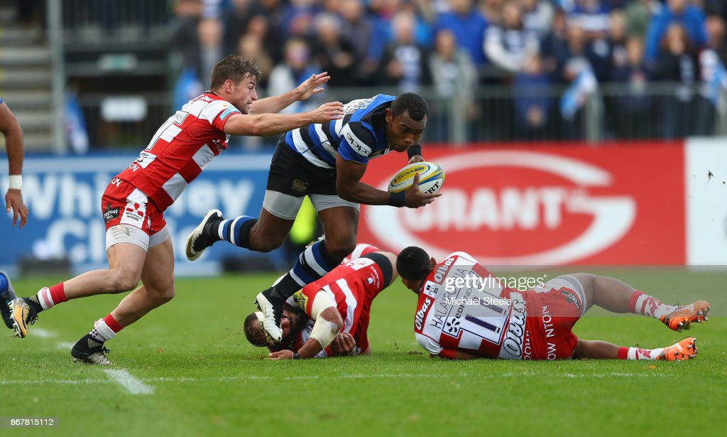Semesa Rokoduguni of Bath is challenged by Henry Trinder (L) and David Halaifonua of Gloucester during the Aviva Premiership match between Bath Rugby and Gloucester Rugby at the Recreation Ground on October 29, 2017 in Bath, England.