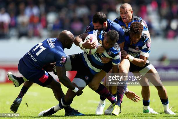 Semesa Rokoduguni of Bath Rugby is tackled and stopped by Djibril Camara Will Genia and Geoffrey Doumayrou of Stade Francais during the European...