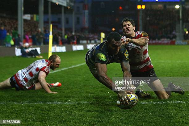 Semesa Rokoduguni of Bath scores his sides second try as James Hook of Gloucester challenges during the Aviva Premiership match between Gloucester...