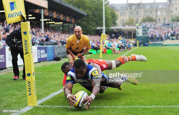 Semesa Rokoduguni of Bath scores the opening try past Vereniki Goneva of Leicester Tigers during the Aviva Premiership match between Bath and...