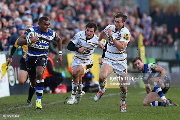 Semesa Rokoduguni of Bath sprints clear of Josh Bassett of Wasps to score his sides opening try during the Aviva Premiership match between Bath Rugby...