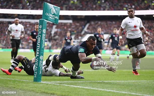 Semesa Rokoduguni of England dives to score his team's third try during the Old Mutual Wealth series match between England and Fiji at Twickenham...