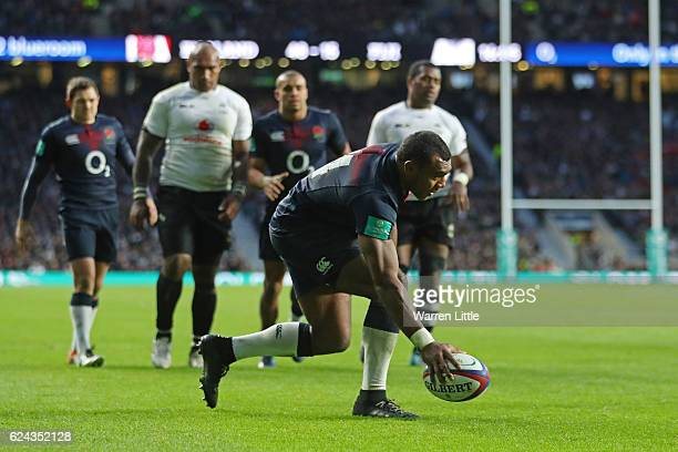 Semesa Rokoduguni of England grounds the ball to score his team's eighth try during the Old Mutual Wealth series match between England and Fiji at...