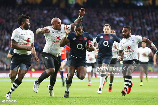 Semesa Rokoduguni of England is tackled by Nemani Nadol of Fiji during the Old Mutual Wealth series match between England and Fiji at Twickenham...