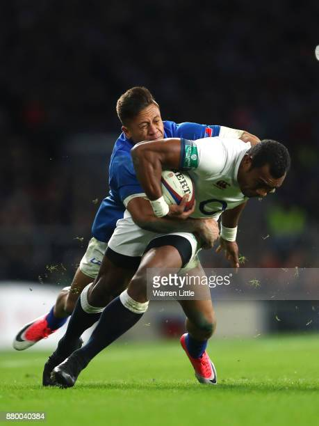 Semesa Rokoduguni of England is tackled by Tim NanaiWilliams of Samoa during the Old Mutual Wealth Series between England and Samoa at Twickenham...
