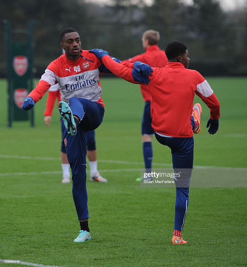 Semi Ajayi and Ainsley Maitland-Niles of Arsenal during a training session at London Colney on December 5, 2014 in St Albans, England.