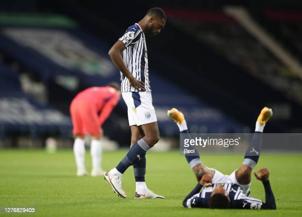 Semi Ajayi and Jake Livermore of West Bromwich Albion look dejected following the Premier League match between West Bromwich Albion and Chelsea at...