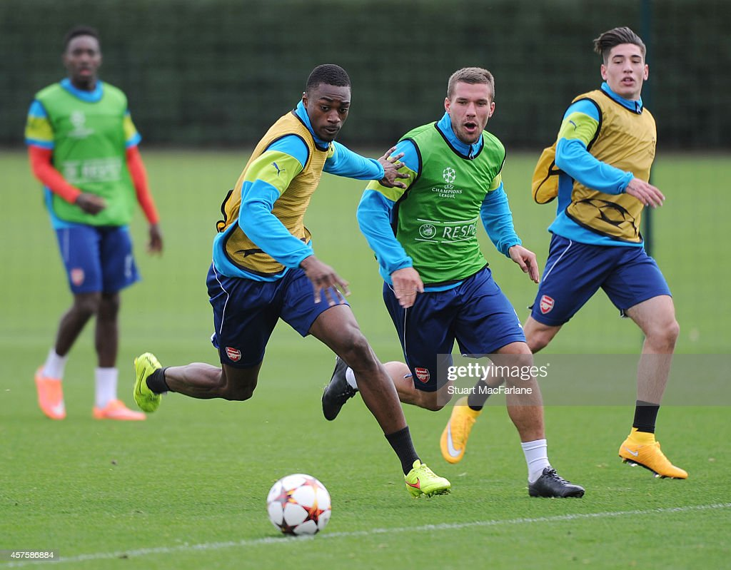 Semi Ajayi and Lukas Podolski of Arsenal during a training session at London Colney on October 21, 2014 in St Albans, England.