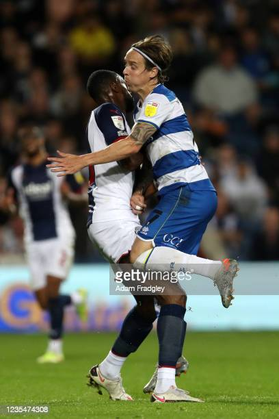 Semi Ajayi of West Bromwich Albion and Stefan Johansen of Queens Park Rangers run into each other during the Sky Bet Championship match between West...