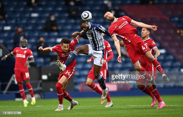 Semi Ajayi of West Bromwich Albion battles for a header with Rhys Williams and Nathaniel Phillips of Liverpool during the Premier League match...