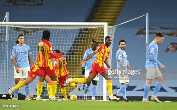 Semi Ajayi of West Bromwich Albion celebrates after his sides first goal which came from a Ruben Dias of Manchester City own goal during the Premier...