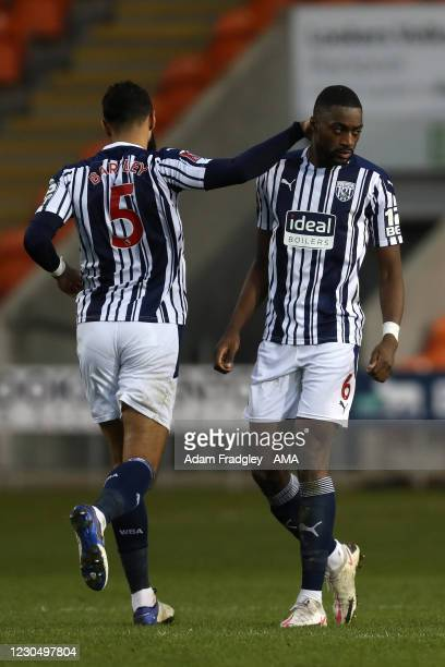 Semi Ajayi of West Bromwich Albion celebrates after scoring a goal to make it 1-1 with Kyle Bartley of West Bromwich Albion during the FA Cup Third...