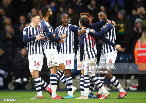 Semi Ajayi of West Bromwich Albion celebrates after scoring his sides second goal with his team mates during the Sky Bet Championship match between...