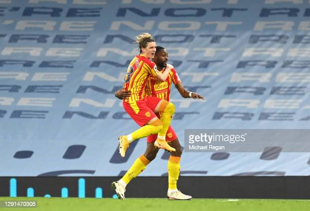 Semi Ajayi of West Bromwich Albion celebrates with teammate Conor Gallagher after his sides first goal which came from a Ruben Dias of Manchester...