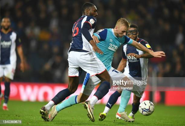 Semi Ajayi of West Bromwich Albion challenges Louie Sibley of Derby County during the Sky Bet Championship match between West Bromwich Albion and...