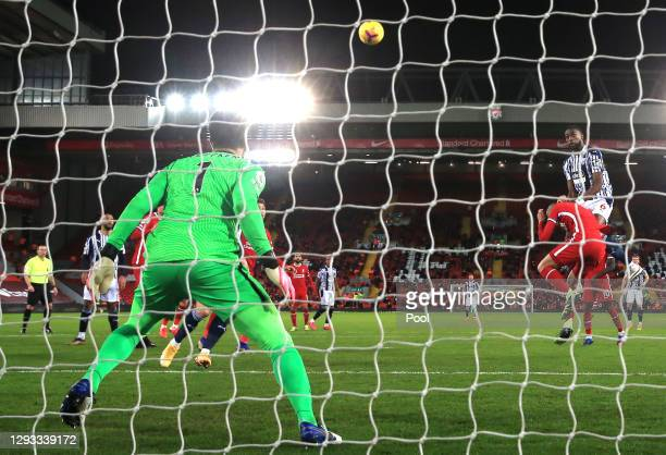 Semi Ajayi of West Bromwich Albion climbs above Fabinho of Liverpool to score their team's first goal during the Premier League match between...