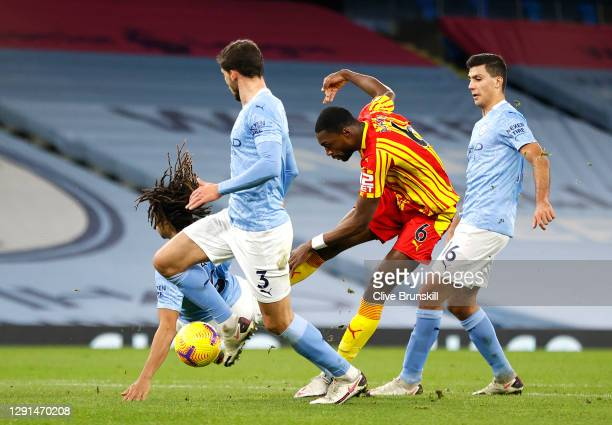 Semi Ajayi of West Bromwich Albion shoots and has his shot deflected by Ruben Dias of Manchester City for West Bromwich Albion's First goal during...