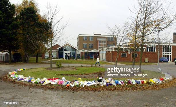 A semi circle of flowers lay outside Birkbeck School North Somercotes Lincolnshire in tribute to Luke Walmsley the 14yearold schoolboy who was...