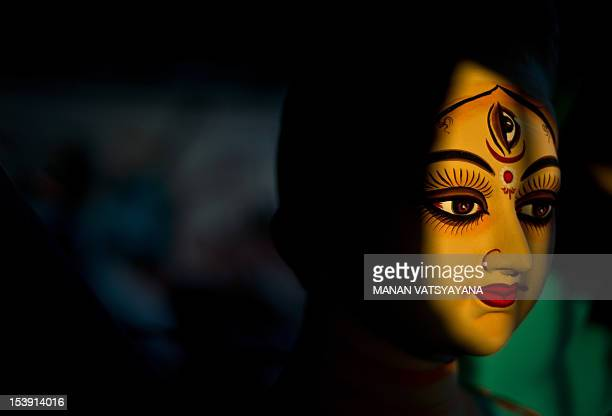 A semi finished clay idol of Hindu goddess Durga is seen at a workshop in New Delhi on October 11 2012 The economic slowdown and rising inflation...