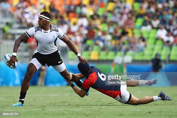 Semi Kunatani of Fiji is tackled by Masakatsu Hikosaka of Japan during the Men's Rugby Sevens semi final match between Fiji and Japan on Day 6 of the...