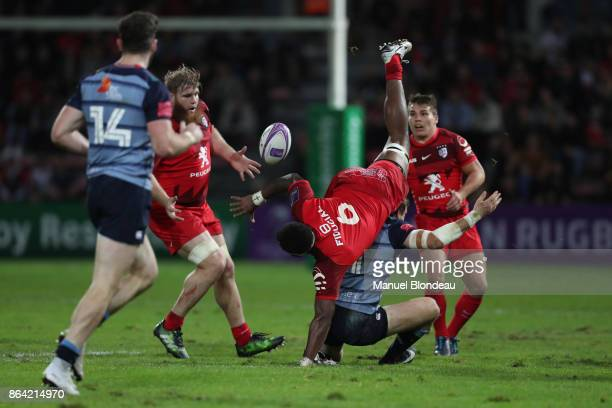 Semi Kunatani of Toulouse and Blaine Scully of Cardiff Blues during the European Challenge Cup match between Stade Toulousain and Cardiff Blues at...