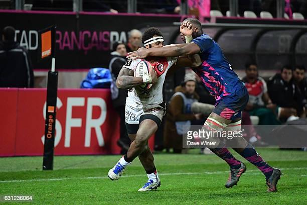 Semi Kunatani of Toulouse takes on Sekou Macalou of Stade Francais Paris during the Top 14 match between Stade Francais and Stade Toulousain on...