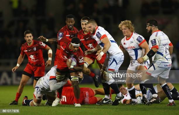 Semi Kunatani of Toulouse tries to break through the Sale Sharks defence during the European Rugby Challenge Cup match between Sale Sharks and...