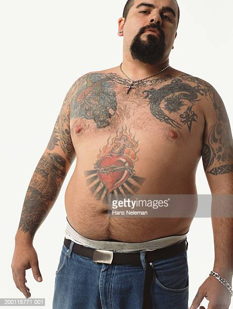 Semi naked man with tattoos and goatee, portrait