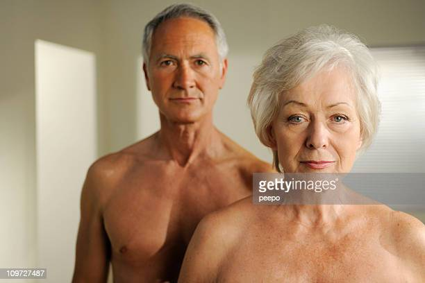 semi nude seniors - naturism stock photos and pictures