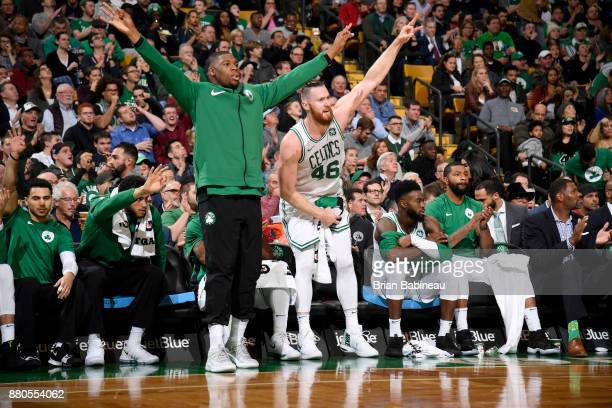 Semi Ojeleye and Aron Baynes of the Boston Celtics celebrate during the game against the Detroit Pistons on November 27 2017 at the TD Garden in...