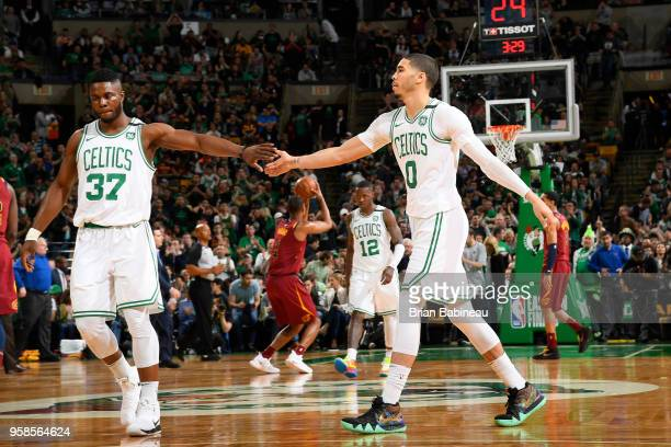 Semi Ojeleye and Jayson Tatum of the Boston Celtics high five in Game One of the Eastern Conference Finals against the Cleveland Cavaliers during the...