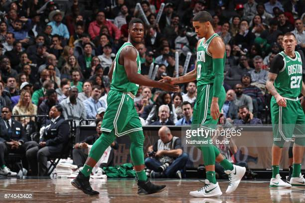 Semi Ojeleye and Jayson Tatum of the Boston Celtics shake hands against the Brooklyn Nets on November 14 2017 at Barclays Center in Brooklyn New York...
