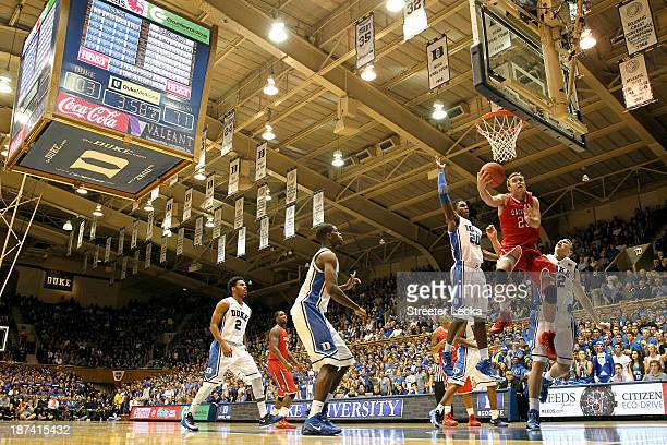 Semi Ojeleye and teammate Alex Murphy of the Duke Blue Devils try to stop Jake Belford of the Davidson Wildcats during their game at Cameron Indoor...