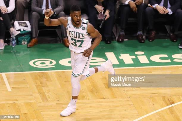 Semi Ojeleye of the Boston Celtics celebrates during the third quarter against the Milwaukee Bucks of Game Seven in Round One of the 2018 NBA...