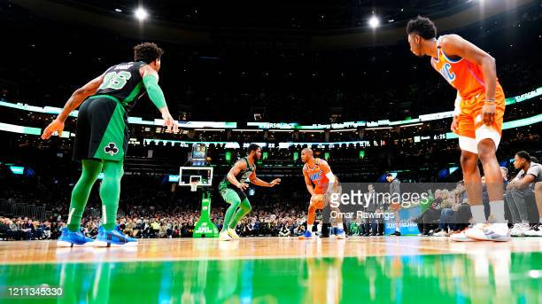Semi Ojeleye of the Boston Celtics defends Chris Paul of the Oklahoma City Thunder during the first quarter of the game at TD Garden on March 08 2020...