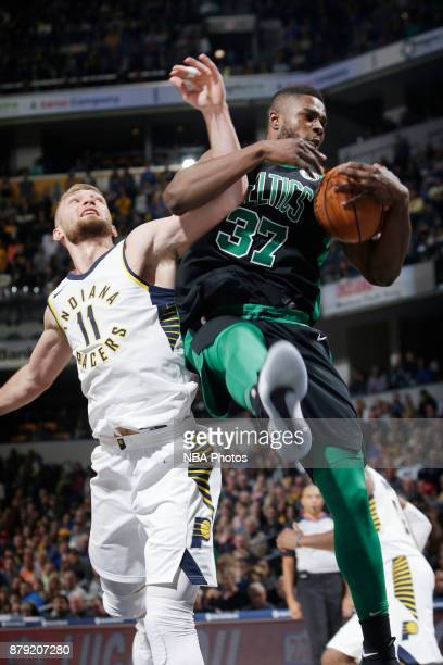 Semi Ojeleye of the Boston Celtics grabs the rebound against Domantas Sabonis of the Indiana Pacers on November 25 2017 at Bankers Life Fieldhouse in...