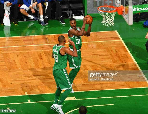 Semi Ojeleye of the Boston Celtics grabs the rebound during the game against the Golden State Warriors on November 16 2017 at the TD Garden in Boston...