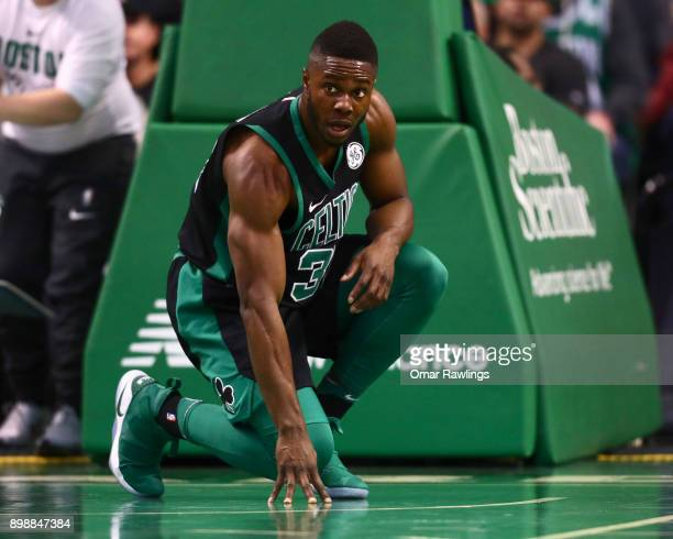 Semi Ojeleye of the Boston Celtics looks on after a hard fall during the game against the Chicago Bulls at TD Garden on December 23 2017 in Boston...