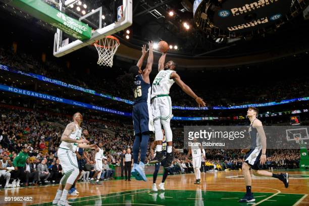 Semi Ojeleye of the Boston Celtics shoots the ball against Kenneth Faried of the Denver Nuggets on December 13 2017 at the TD Garden in Boston...