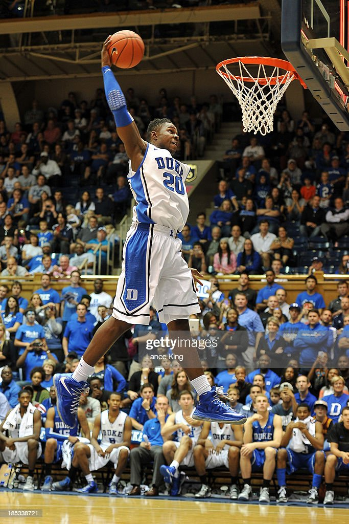 Semi Ojeleye #20 of the Duke Blue Devils competes in a dunk contest during Countdown to Craziness at Cameron Indoor Stadium on October 18, 2013 in Durham, North Carolina.