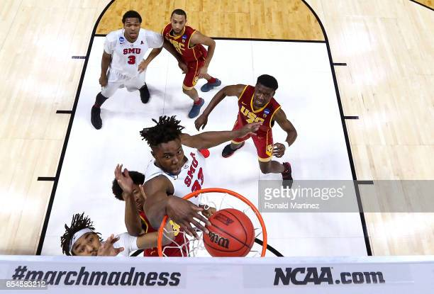 Semi Ojeleye of the Southern Methodist Mustangs dunks in the second half against Elijah Stewart of the USC Trojans during the first round of the 2017...