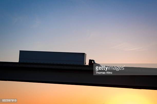 Semi on a freeway overpass