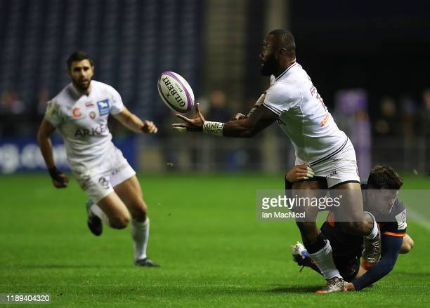 Semi Radrada of Bordeaux is tackled by Blair Kinghorn of Edinburgh Rugby during the European Rugby Challenge Cup Round 2 match between Edinburgh...
