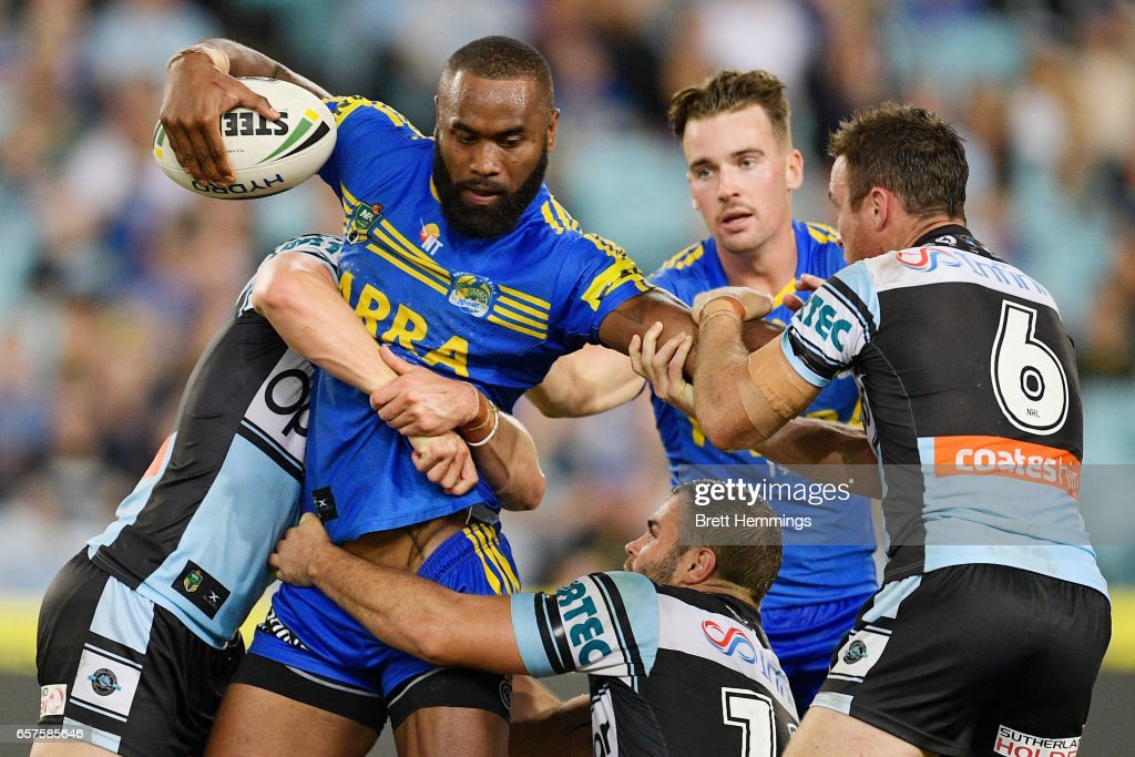 Semi Radrada of the Eels is tackled during the round four NRL match between the Parramatta Eels and the Cronulla Sharks at ANZ Stadium on March 25, 2017 in Sydney, Australia.