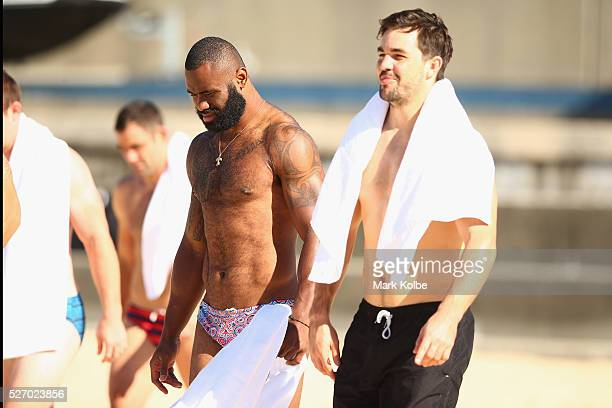 Semi Radradra and Aidan Guerra walk to the water during the Australia Kangaroos Test team recovery session at Coogee Beach on May 2 2016 in Sydney...