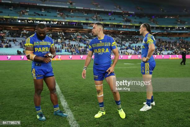 Semi Radradra Corey Norman and Brad Takairangi of the Eels look dejected at fulltime during the NRL Semi Final match between the Parramatta Eels and...