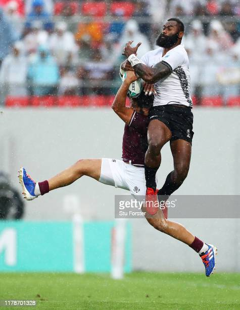 Semi Radradra of Fiji competes in the air for the ball with Giorgi Kveseladze of Georgia during the Rugby World Cup 2019 Group D game between Georgia...