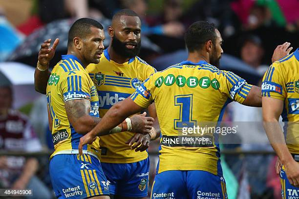 Semi Radradra of the Eels celebrates with his team mates after scoring a try during the round 24 NRL match between the Manly Warringah Sea Eagles and...