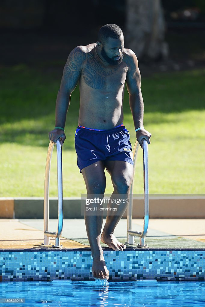Semi Radradra of the Eels feels the water temperature during a Parramatta Eels NRL recovery session at Pirtek Stadium on May 13, 2014 in Sydney, Australia.